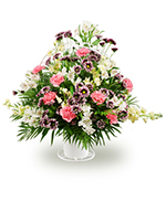Mixed flowers in a handheld basket